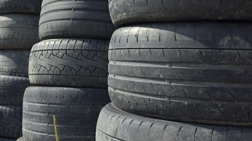 Stacks Of Old Used Car Tyres Disposal Site
