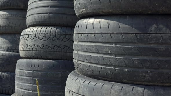 Thumbnail for Stacks Of Old Used Car Tyres Disposal Site