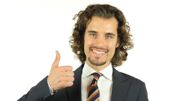 Thumbnail for Thumbs Up by Young Businessman w/ Curly Hairs