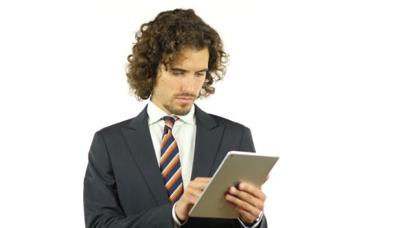 Thumbnail for Businessman Browsing on Tablet, Searching Information