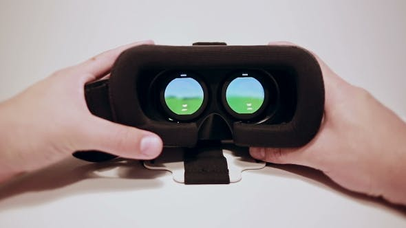 Thumbnail for Virtual Reality Glasses For The Smartphone, Smartphone Is Working, Colored Miniature, Mans Hands