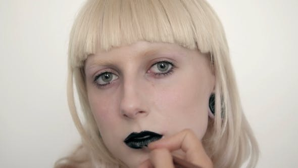 Thumbnail for Girl In The Image Of Albino With Black Lips And White Eyes. Art Beauty Face. Picture Taken In The