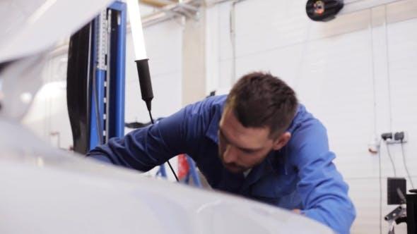 Thumbnail for Mechanic Man Repairing Car At Workshop 21