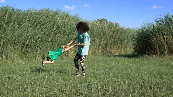 Thumbnail for Happy Daughter And Mother Enjoying Outdoors.