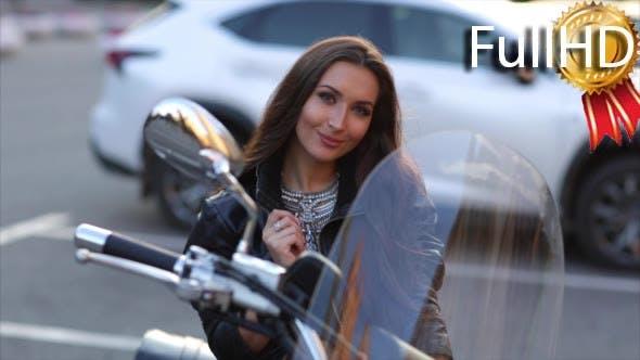Woman Biker in a Leather Jacket Posing
