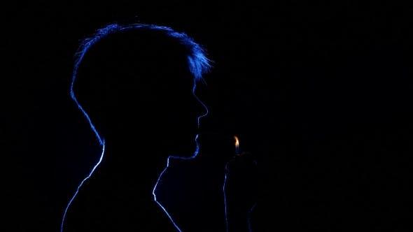 Thumbnail for Man Lighting Cigarette. Back Light. Silhouette