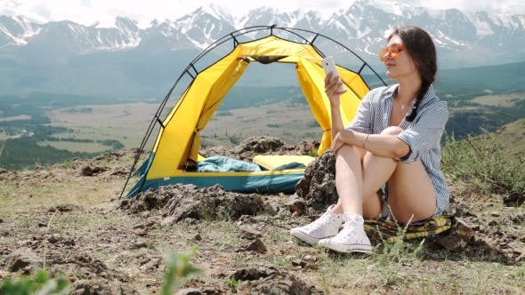 Thumbnail for Young Women Camping Tents On Shore The Morning