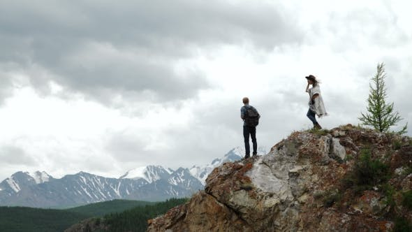 Thumbnail for Two People Standing On Top Of a Mountain