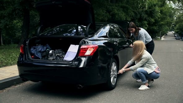 Thumbnail for Woman Driver Trying To Remove Wheel With Wrench