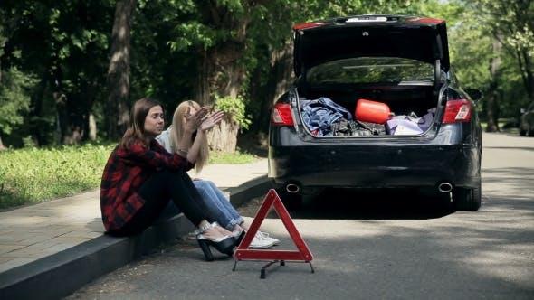 Thumbnail for Upset Women Sitting On Roadside Car Is Broken Down