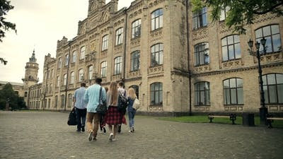 Group Of Students Walking To The University