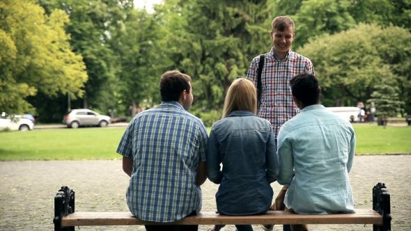 Cover Image for Rear View Of Students Sitting On Bench After Exam