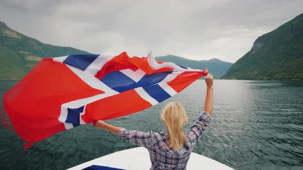Thumbnail for Young Woman with Norway Flag on Fjord Cruise