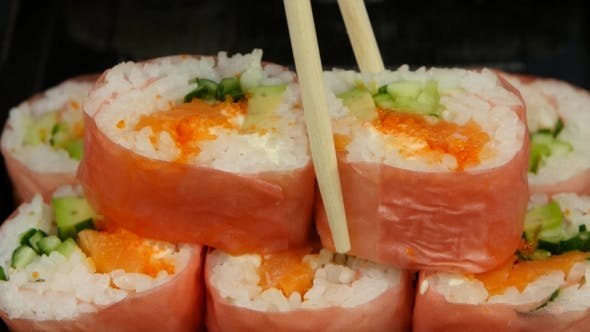 Thumbnail for Chef Puts Sushi In Pink Norrie In a Bowl.