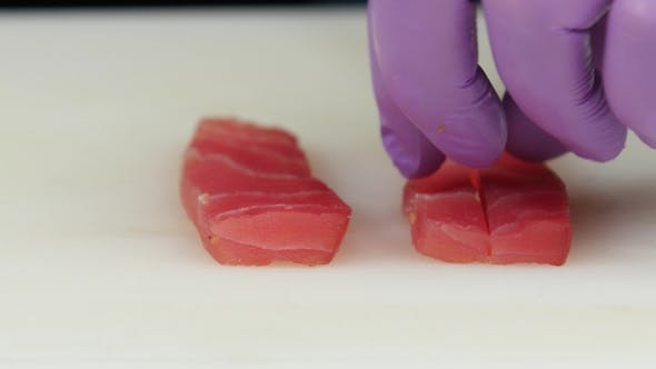 Thumbnail for Chef Lays Out Thin Slices Of Fish