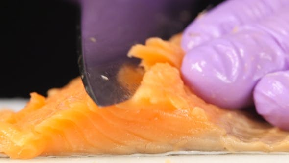 Thumbnail for Sushi Chef Cuts a Slice Of Trout.