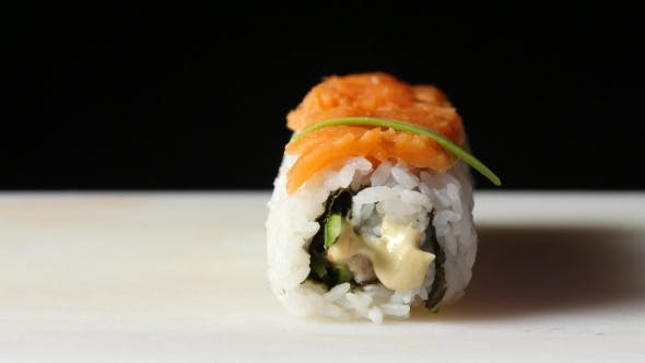 Thumbnail for Chef Decorates The Roll With Pieces Of Avocado