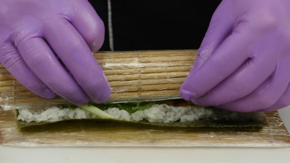 Cover Image for Chef Uses a Bamboo Mat For Preparing Sushi.