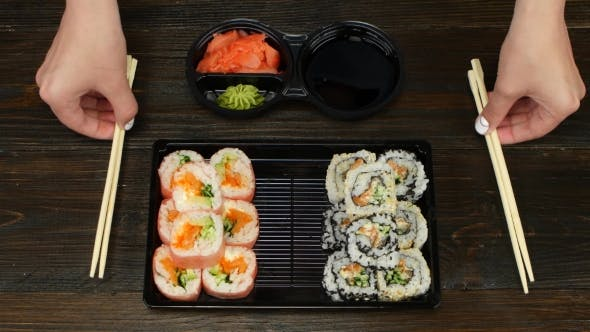 Rolls Ready For Catering. Sushi In Plastic Dishes.