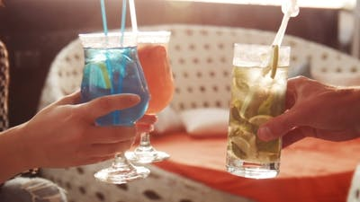 Hands Holding Drinks