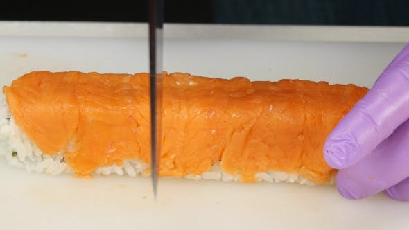 Thumbnail for Chef Cuts The Ready Roll In Half.