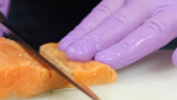 Thumbnail for Chef Cuts Slices Of a Red Fish.
