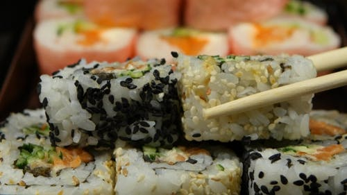People Form The Rolls Or Sushi Cooked To Order