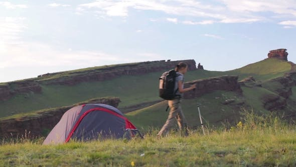 Thumbnail for Young Woman Prepares Backpack And Walks Away From Camp