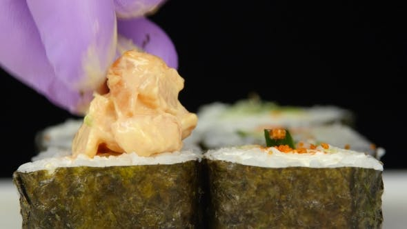 Thumbnail for Chef Decorates The Rolls Before Serving.