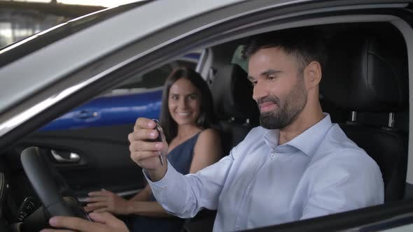 Thumbnail for Happy Buyers Taking Key Sitting in New Auto