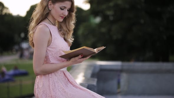 Thumbnail for Beautiful Girl Reading a Book In a Park And Dreaming About Love