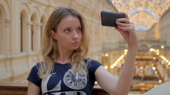 Thumbnail for Young Slim Blonde Taking Selfie In Shopping Mall