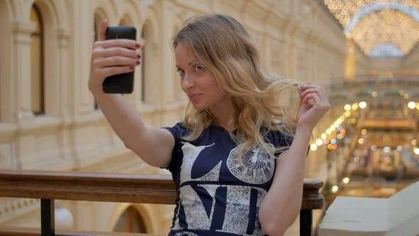 Cover Image for Young Slim Blonde Taking Photo By Smartphone In Shopping Mall