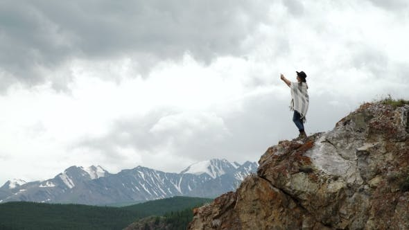 Thumbnail for Woman Hiker Taking Photo With Smart Phone At Mountain Peak Cliff