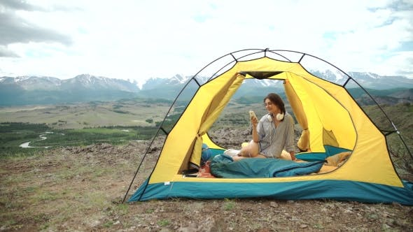 Thumbnail for Young Woman Listening To An Mp3 Player In a Tent