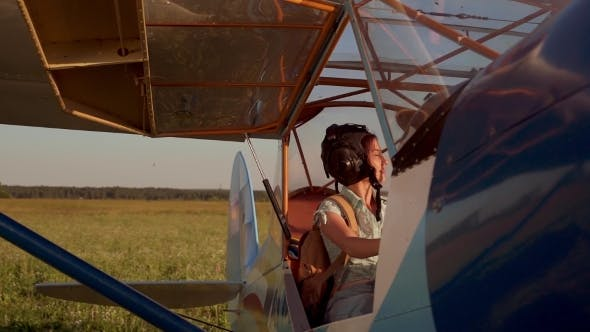 Thumbnail for Girl Controlling An Old Airplane