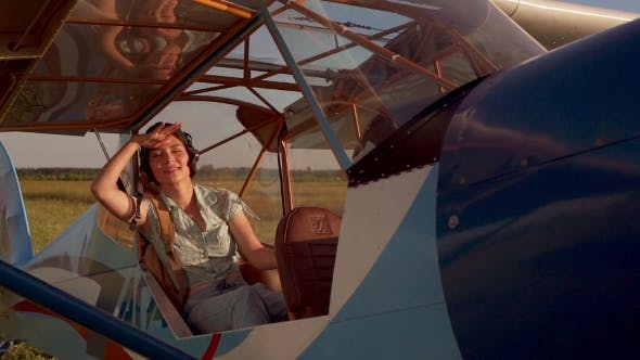 Thumbnail for Girl Sitting In An Old Airplane