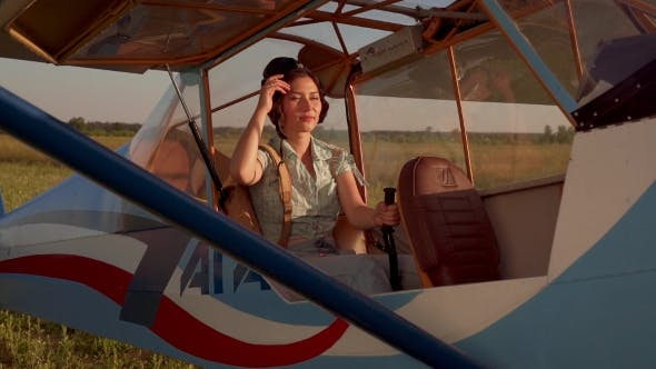 Thumbnail for Female Pilot In An Old Airplane