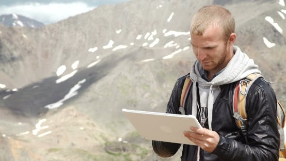 Thumbnail for Man Working Outdoors With Tablet Computer