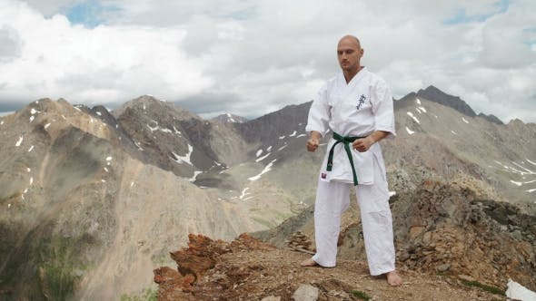 Thumbnail for Kickboxer Or Muay Thai Fighter Practicing Shadow Boxing On a Mountain