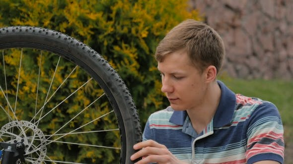 Thumbnail for The Young Man Turns The Wheel Of The Bicycle.