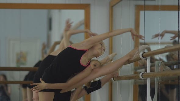 Thumbnail for Artistic Gymnasts Warming up at the Mirror