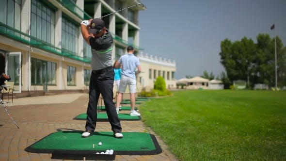 Thumbnail for The Young Man Play Golf Near Th Clubhouse