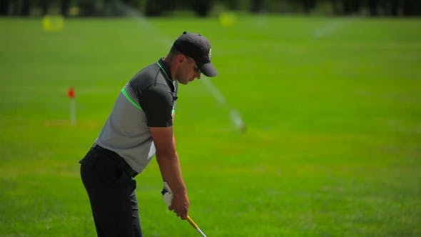 Thumbnail for The Man Concentrates On The Ball During a Golf