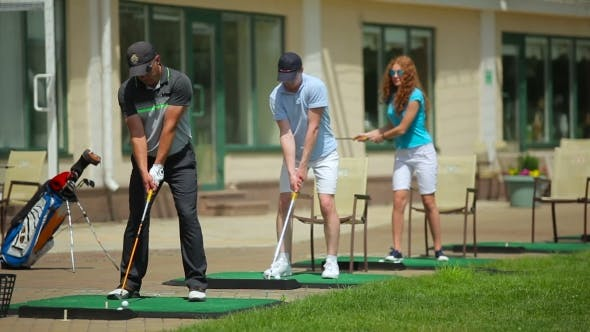 Thumbnail for Young People Play Golf Near The Clubhouse
