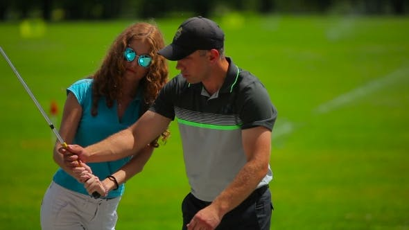 Cover Image for The Man Train a Girl How To Hit The Ball In Golf