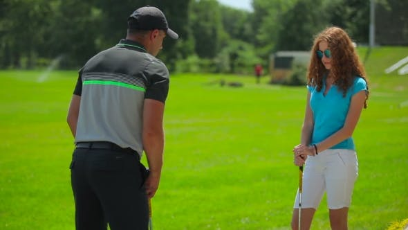 Thumbnail for The Man Show The Woman Position In Golf