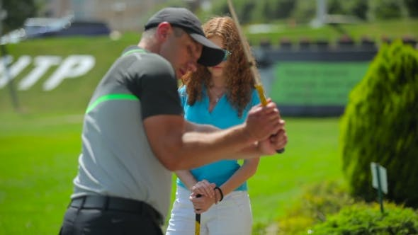 Thumbnail for The Man Train The Woman To Hit The Ball In Golf