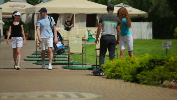 Thumbnail for Golf Players Are Talking Near The Golf Field