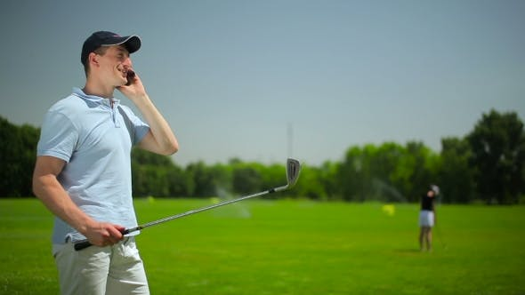 Thumbnail for The Young Man Talking On The Phone At The Course